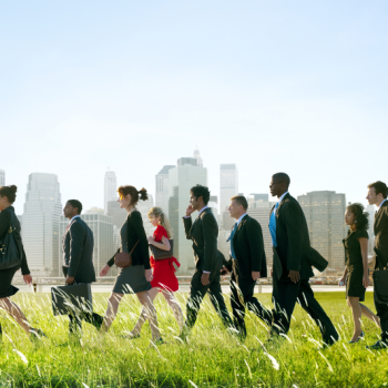 Business People walking in the grass