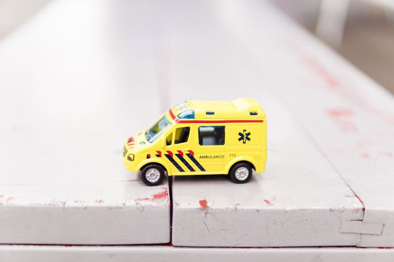 Emergency toy vehicle on a bench