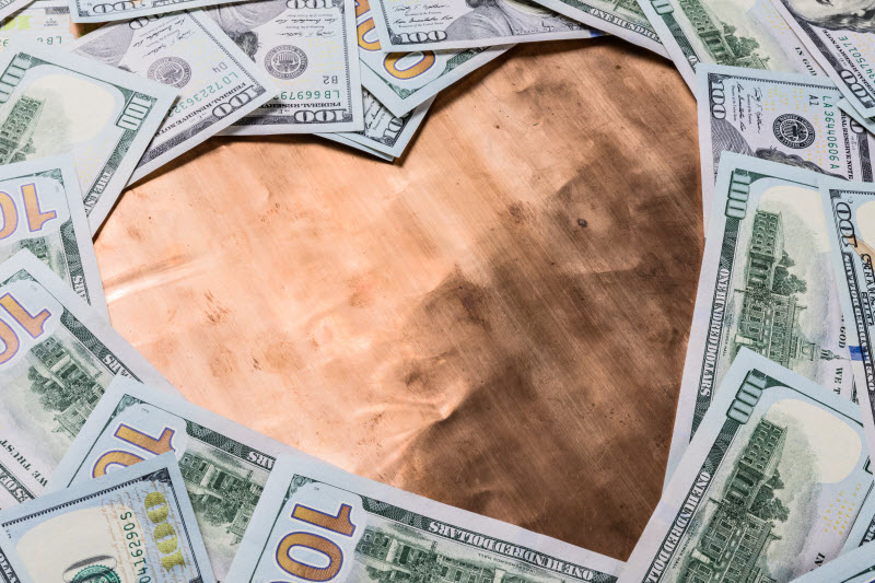 Bronze heart and hundred dollar bills