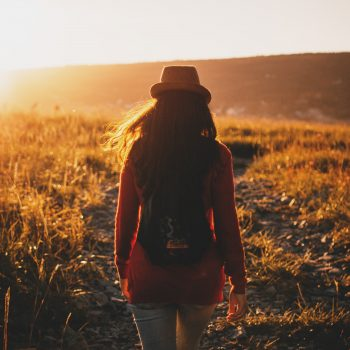 Woman walking in a field finding purpose