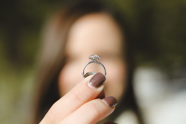 Woman Holding Unique Ethical Engagement Ring