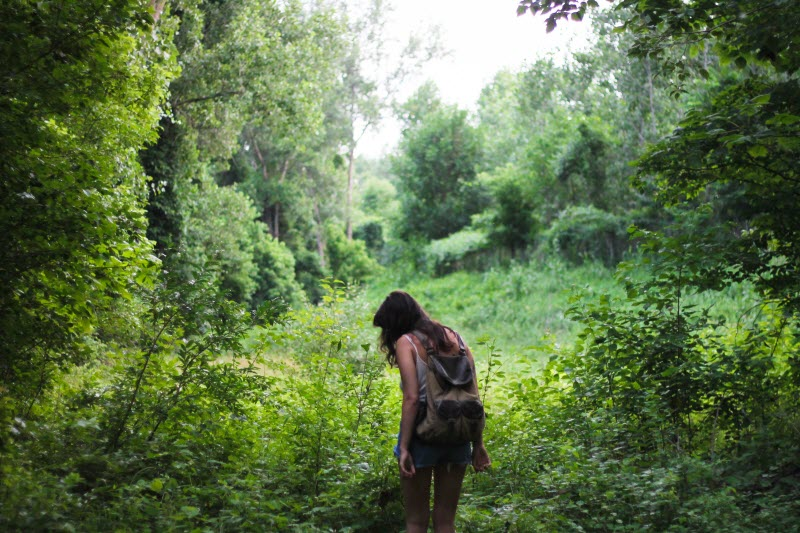 Woman walking in jungle
