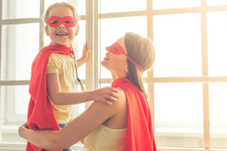 mother and daughter dressed as super heroes