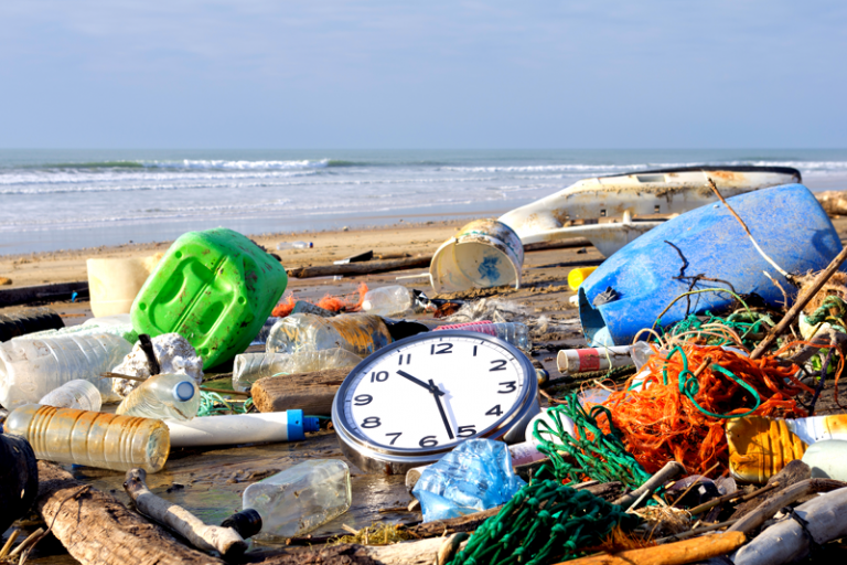 garbage and a clock on the beach