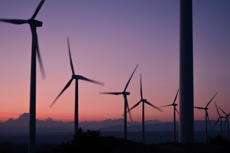 picture of windmills at sunset