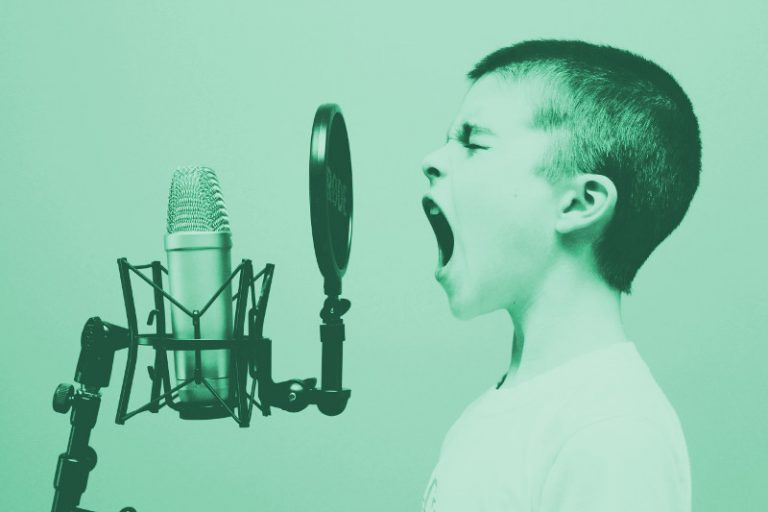 boy screaming into a microphone