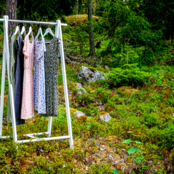 cotton dresses hanging in a forest