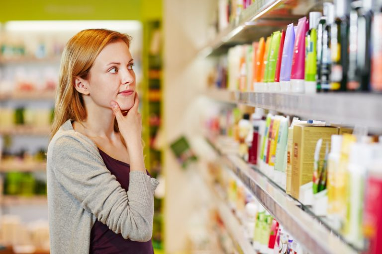 women confused in front of personal care products