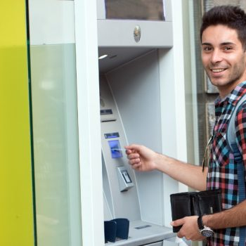 Young man using an ATM
